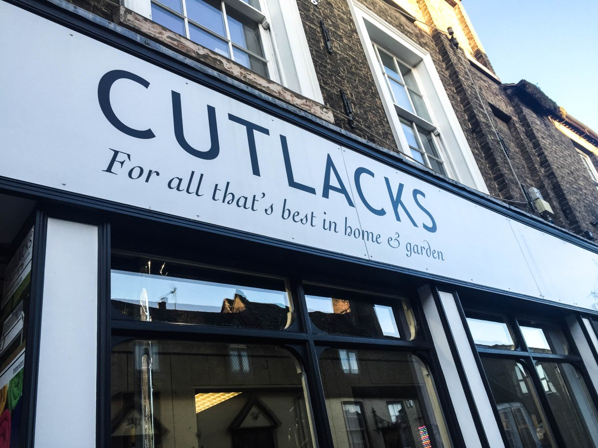 A photograph of Cutlacks shop front in Ely.