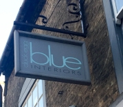 A photograph of the Duck Egg Blue Interiors shop sign in Ely.