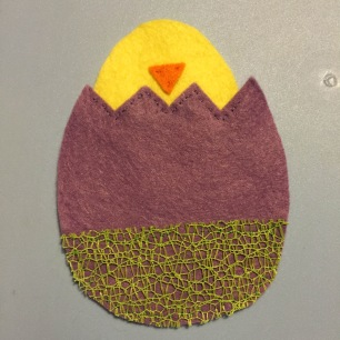 Photo of Emma's egg with a chick's head poking out of the top