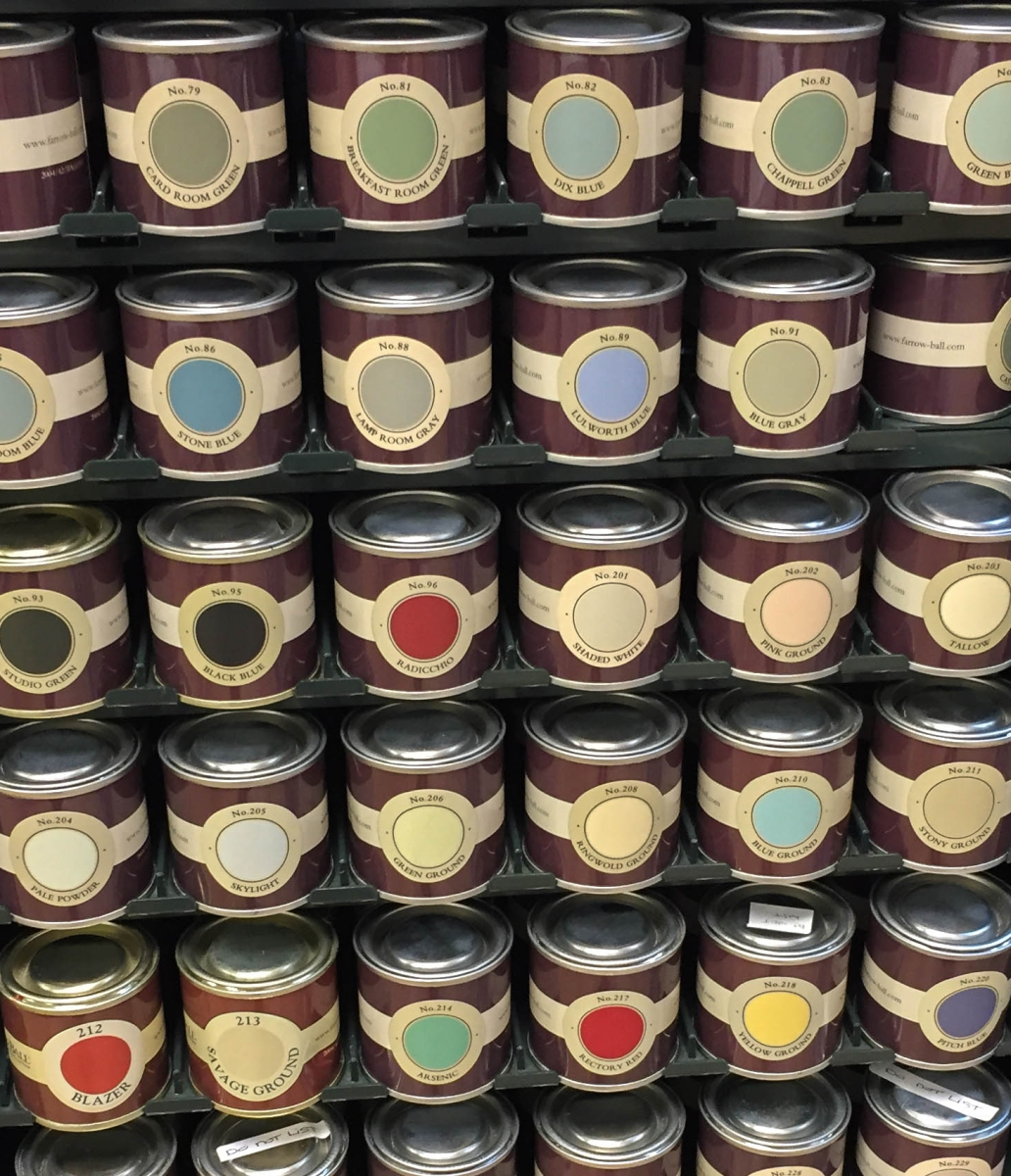 A wall display of Farrow & Ball sample paint pots.