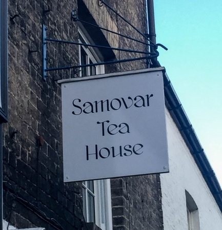 A photograph of the Samovar Tea House shop sign in Ely.