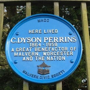 Photo of a Malvern Civic Society blue plaque outside C Dyson Perrins former home.