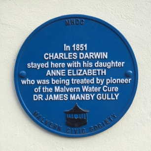 A photo of a Malvern Civic Society blue plaque outside a house where Charles Darwin stayed with his daughter Anne Elizabeth in 1851.