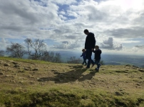 A photo of Rob and the boys walking on the hills, away from the main pathway.