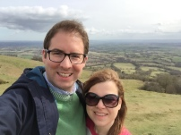A photo of Rob and Emma taken at the top of their walk up British Camp