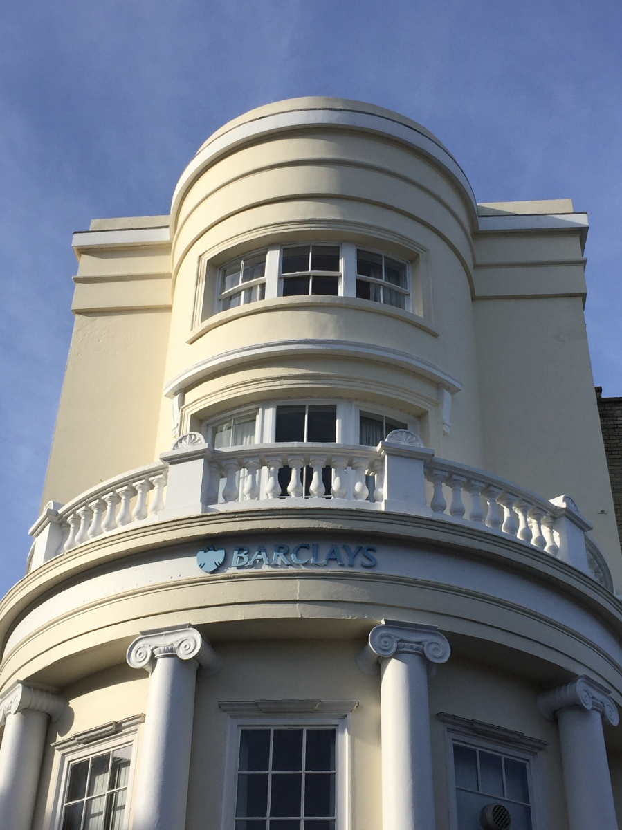 Photo of a stunning cream building with balcony which is now home to Barclays. It was built in 1819 as the site of the Royal Library.