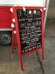 A photo of the Churros Bar sign showing what's on their menu