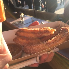 A photo of three Sugar and Cinnamon Churros with Salted Caramel Dip ready to eat