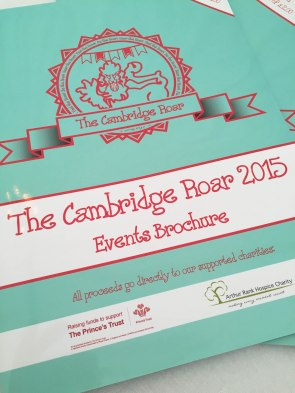 A photograph of the Cambridge Roar events brochure