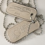 A photograph of the silver dog tags that the runners received for taking part in the race.