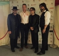 A photograph of The UK Bee Gees with Cambridge Roar Chairman, Tony Murdock.