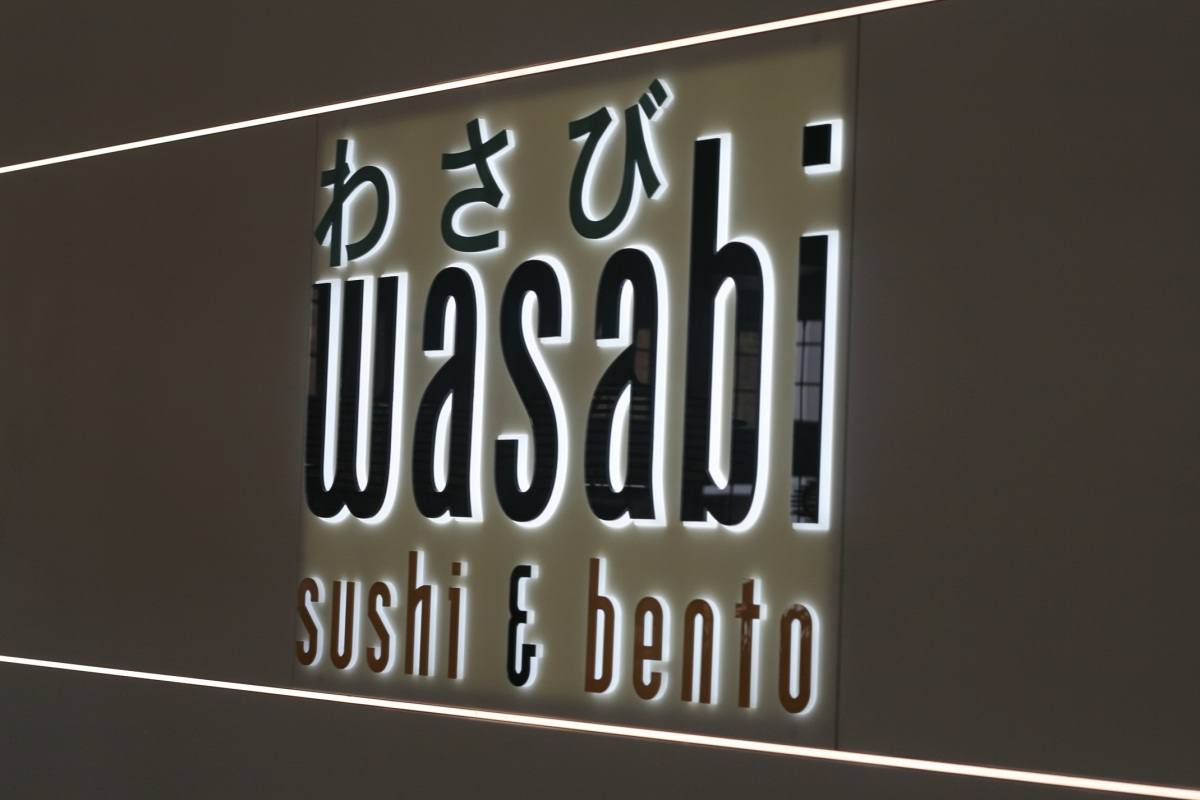 A photograph of the Wasabi signage. Photograph courtesy of Alice Toby-Brant of http://www.themiddlesister.co.uk/