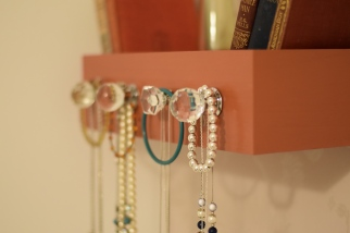 A close up of the hanging necklaces and bracelets