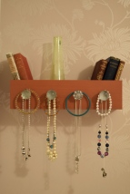 A photograph of the finished jewellery holder mounted on the wall