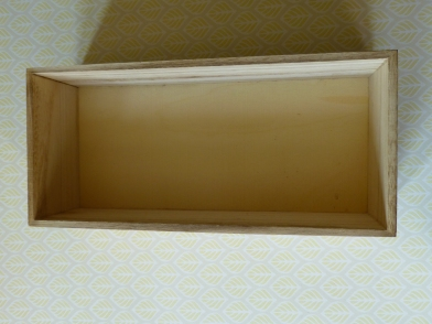 A photograph of the plain wooden box