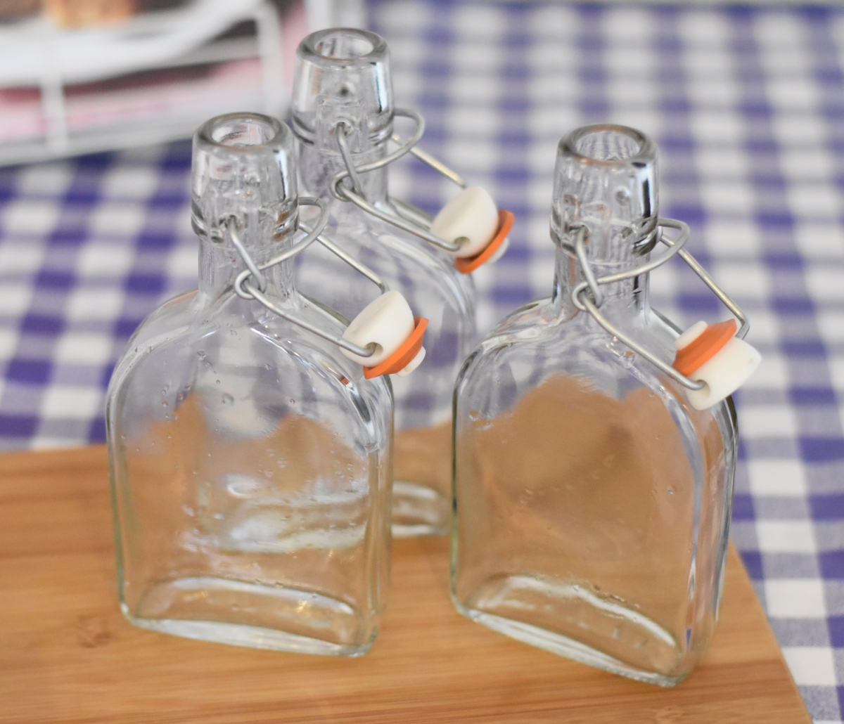 A photo of three empty bottles ready to be filled.