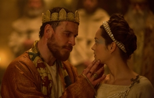 A photograph of Michael Fassbender as Macbeth and Marion Cotillard as Lady Macbeth at the banquet.