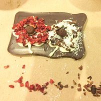 A photograph of Emma's decorated chocolate slab. Red flower on the left and white flower on the right