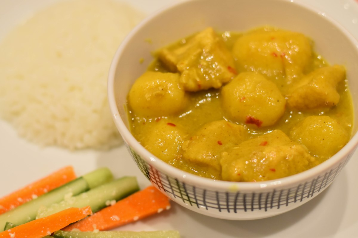 A photograph of the Opor Ayam with Jasmine Rice; the tastiest curry ever cooked in Emma and Rob's kitchen