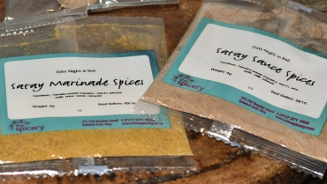 A close up photograph of the satay marinade spices and satay sauce spices