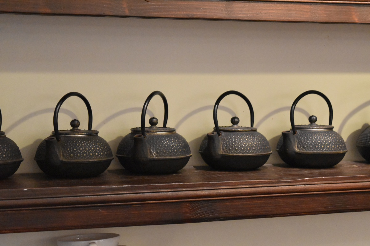 A photograph of some gorgeous cast iron teapots that can be bought in the Samovar Tea House.