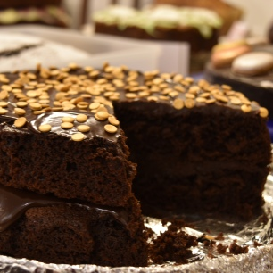 A close up photograph of the dark chocolate and orange cake with a slice taken out.