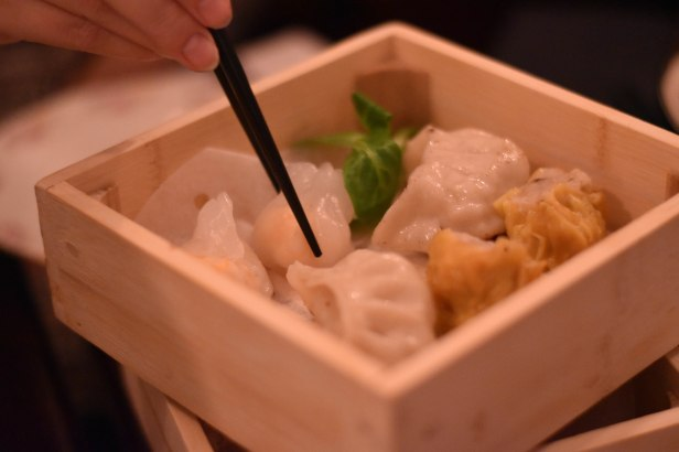 A photograph of pork Siu Mai, prawn dumplings, pan fried dumplings