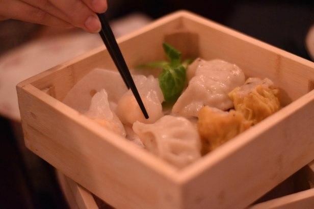 A photograph of pork Siu Mai, prawn dumplings, pan fried dumplings