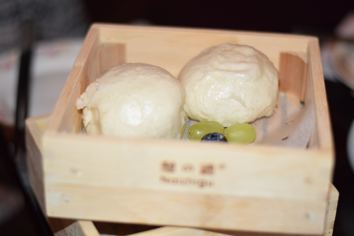 A photograph of two egg cream buns