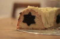 A close up photograph of the mint chocolate star cake in cross-section. The star runs through the middle of the entire bundt cake.