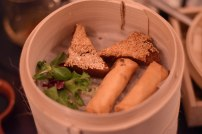 A photograph of crispy sesame prawn toast and spring rolls