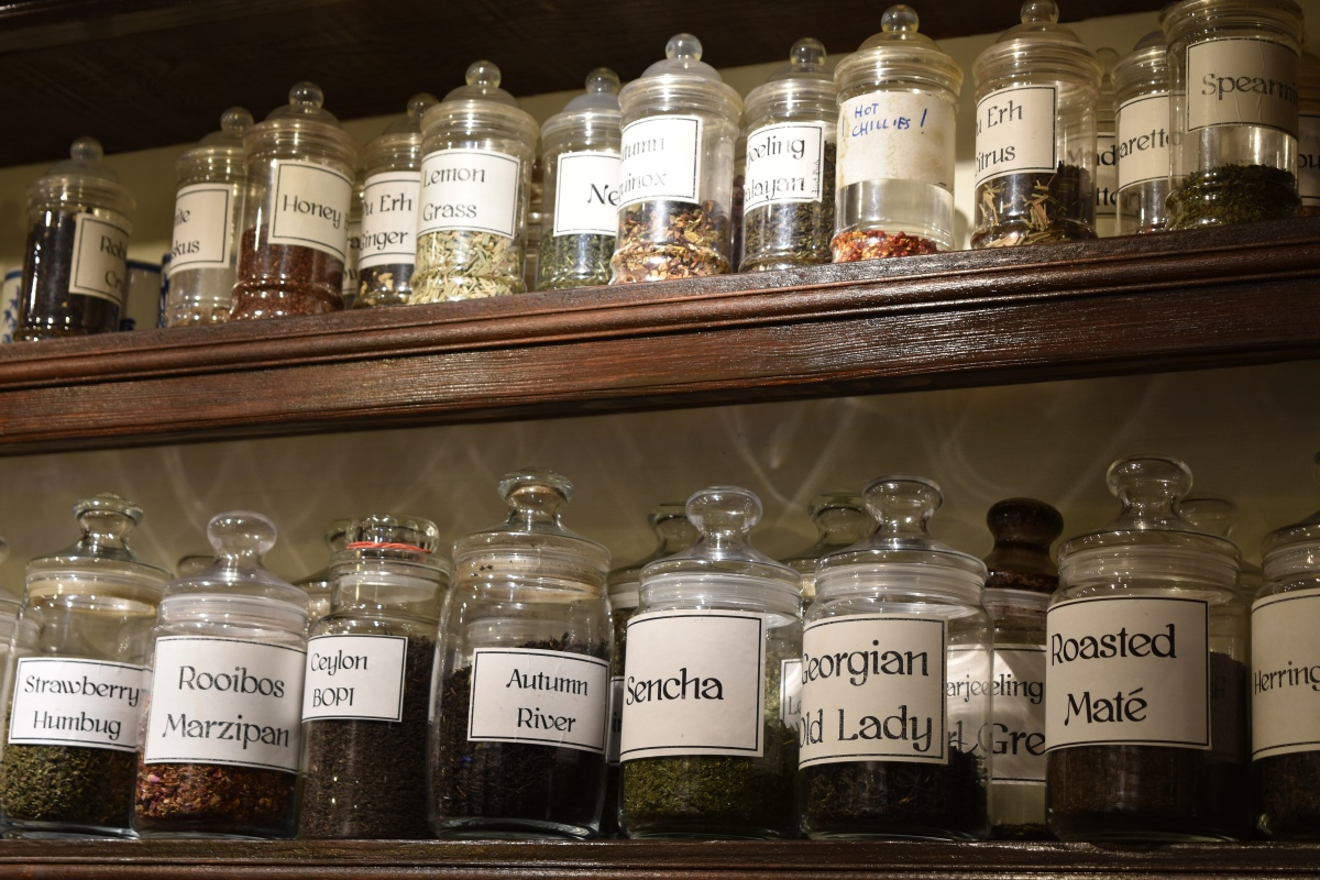 A photograph of two shelves of tea. Just a fraction of the teas available from Samovar Tea House.