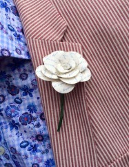 A photograph of the paper buttonhole, on the groom, made by Julie for a wedding