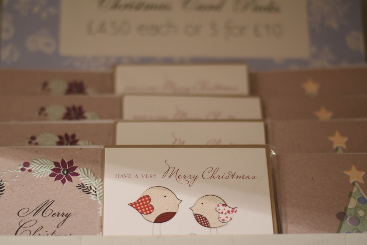 A photograph of a display of Christmas cards designed by Julie