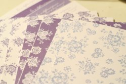 A photograph of sheets of card with Julie's signature pattern: Dinky Floral