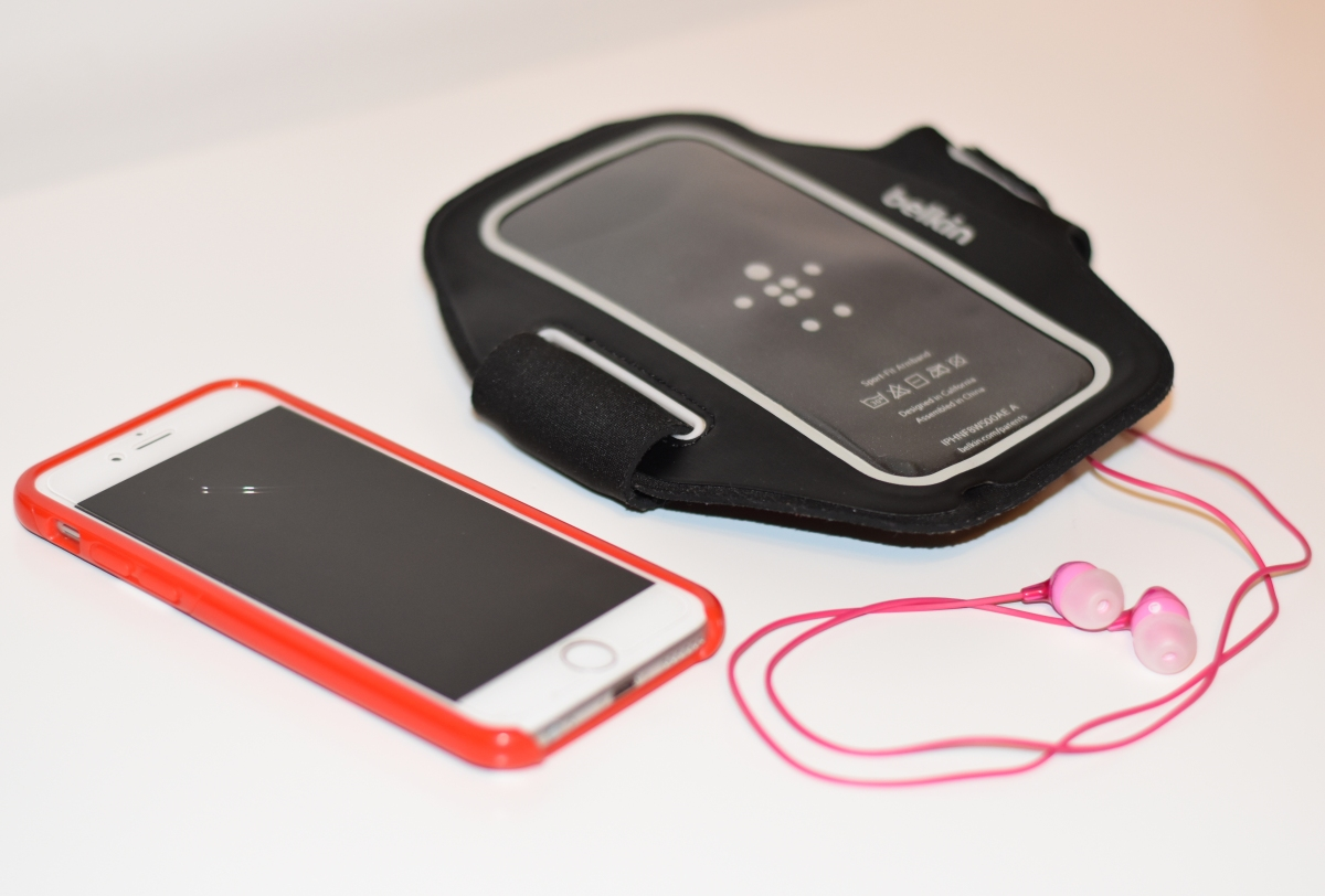 A photo of the equipment Emma needed for her runs: mobile, headphones and a Belkin phone holder which straps to Emma's arm