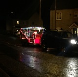 A photo of Father Christmas in a car-drawn sleigh making his annual round to see the children of Ely.