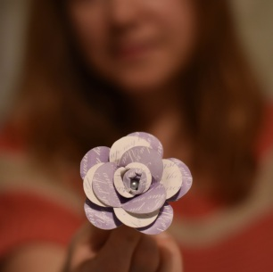 A photograph of Emma's flower with Emma in the background
