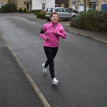 A photograph of Emma running with both feet slightly off the ground. Flying feet!
