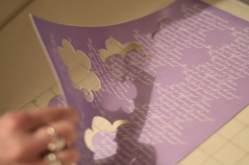 A photograph of a sheet of card with the flower shapes cut out