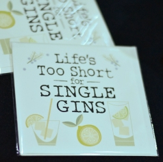 "A photograph of cards for sale with the slogan ""Life's too short for single gins"""