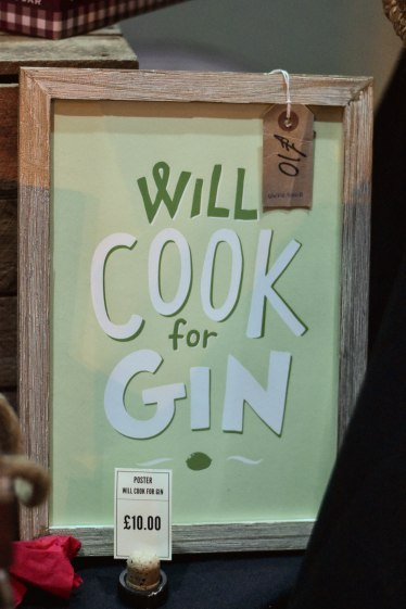 """A photograph of a poster for sale with the slogan """"Will cook for gin"""""""