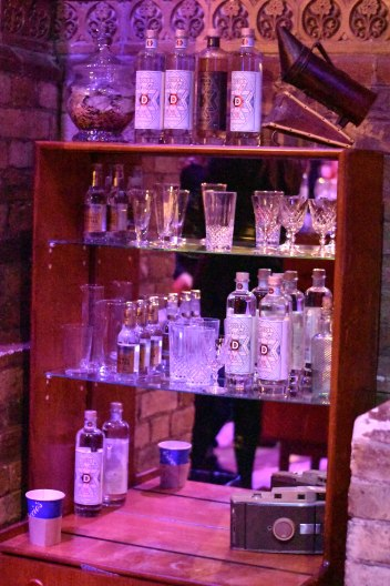 A photograph of a pretty cabinet full of Dodd's bottles, glasses and memorabilia