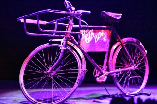 """A photograph of an old fashioned bike labelled """"Gin bike"""""""