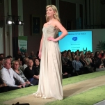 A photograph of a model wearing KFD Jewellery paired with dress from Burr Bridal