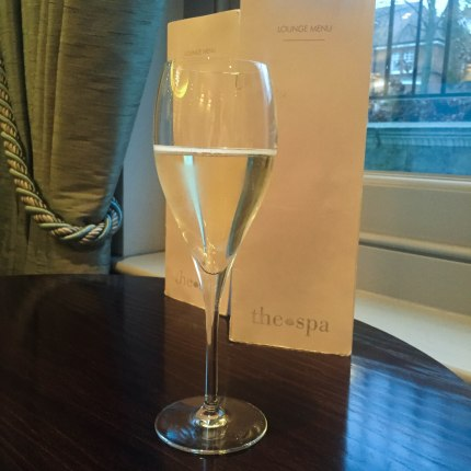 A photograph of a glass of Prosecco that Emma had while waiting for her husband
