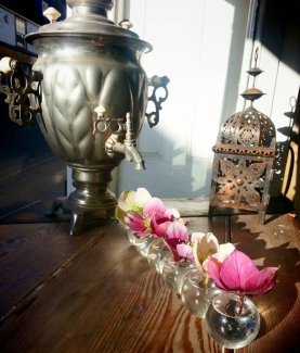 A photograph of a beautiful samovar with fresh flowers; a regular feature in the tea house