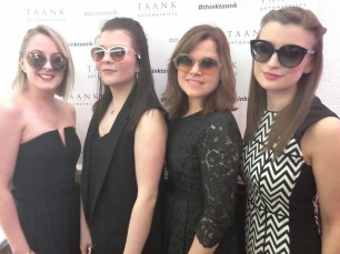 A team photograph in Taank Optometrists. The girls are wearing designer sunglasses