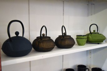 A photograph of some cast iron teapots for sale
