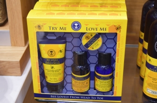 A photograph of the Bee Lovely products in a gift box